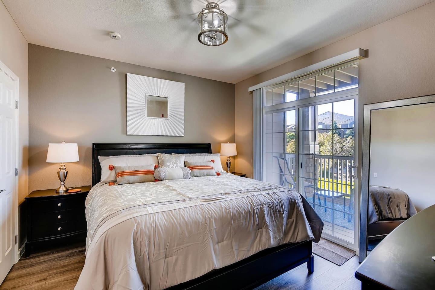 """Master Bedroom Suite with Walk-in Closet, 4 piece private bathroom with 2 sinks, 42"""" TV, & Private Balcony with Seating, Newly Remodeled"""