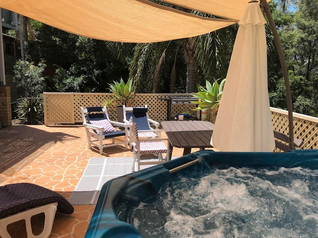 Relax in the outdoor spa under the stars!