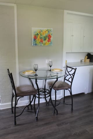 Table offers dining for two and easily seats up to 4. Extra chairs are available