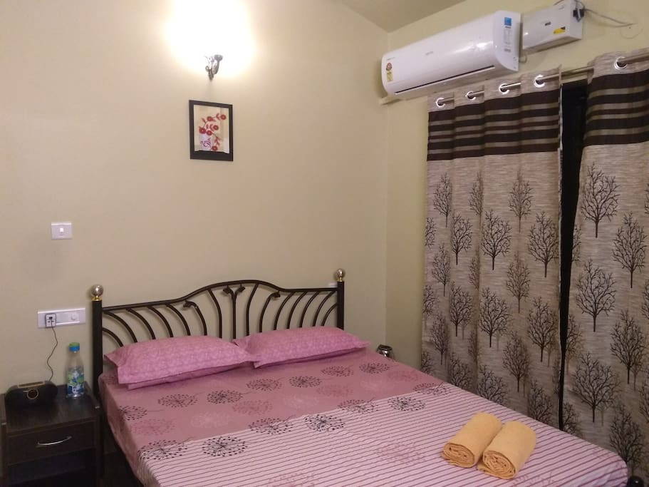Room with king sized bed and Air conditioning