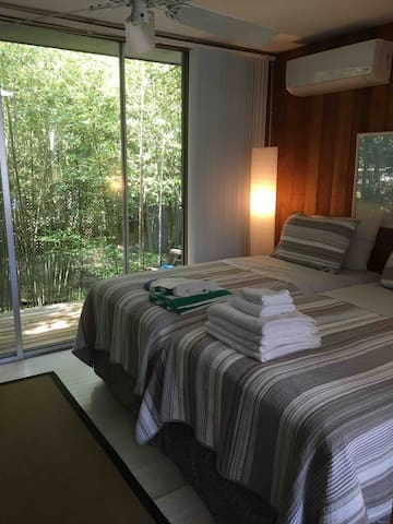 Garden view with direct access to private deck. Room includes its own TV and A/C / heater.