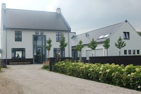 Luxe gastenverblijf  in het hart van Zuid Limburg - Huoneisto