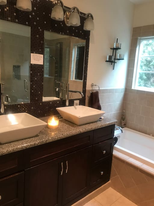 Shared bathroom with shower and soaking tub