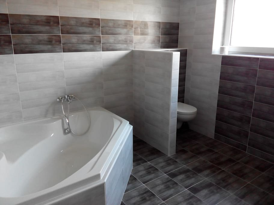 Bathroom with the bath and toilet
