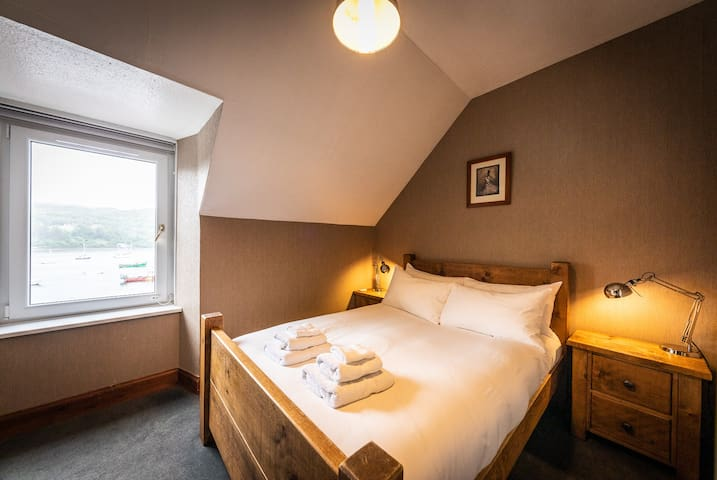 The Ensuite room, views to die for and a loo with a view! Double bed with Luxury Hungarian Goosedown bedding. Bespoke hand made wooden furniture and luxury carpets throughout.