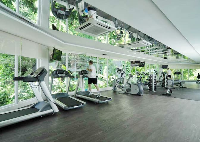Well equipped gym facing the forest.