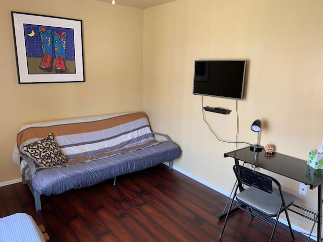 Private room includes access to wall mounted TV and private desk.