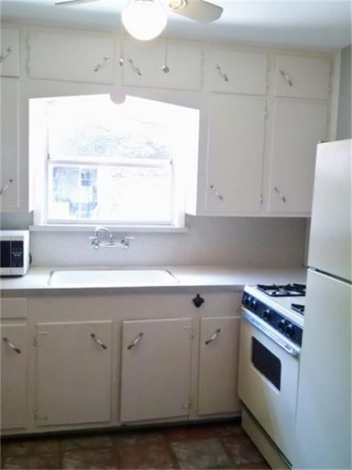 Full kitchen.  With dishes, utensils and pans.  Microwave and coffee maker.