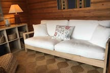 The sauna dressing room with the bed sofa