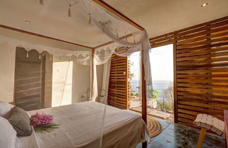 King bedded garden room at Villa Cosmos