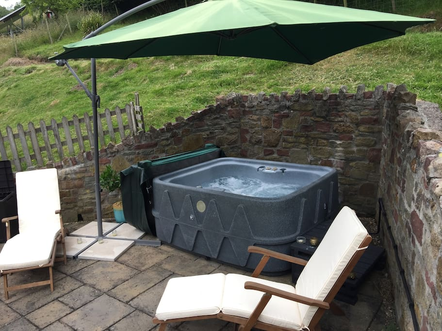 The Hot Tub patio - a sun trap and relaxing area.