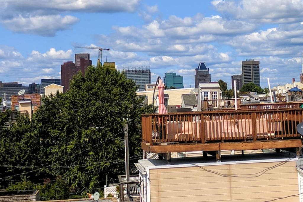 You'll truly enjoy the stunning Downtown Baltimore Skyline views as pictured here on top of our homes rooftop deck. Watching sunsets from the rooftop deck are also a must!