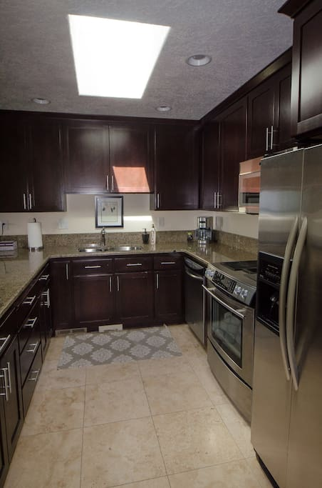 Full kitchen with new in 2017 convection microwave