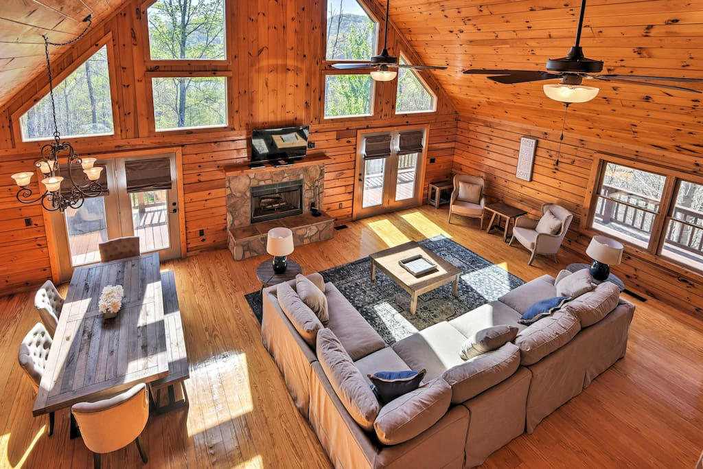 The living room boasts a large sectional, 50-inch flat screen cable TV with Roku and a gorgeous stone fireplace for warming your toes on those chilly winter nights.