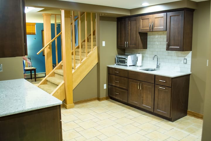 Newly renovated kitchenette includes microwave, toaster oven, sink, and two mini fridges