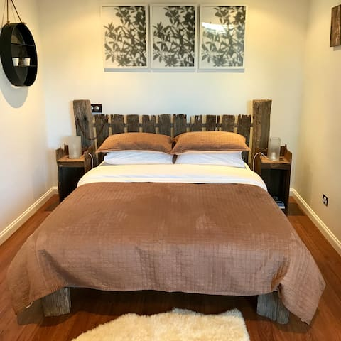"""Queen size bed with quirky farm fence bed head - """"The most comfortable bed we have ever had in any accomodation"""" - Sharon & James, September 2017"""