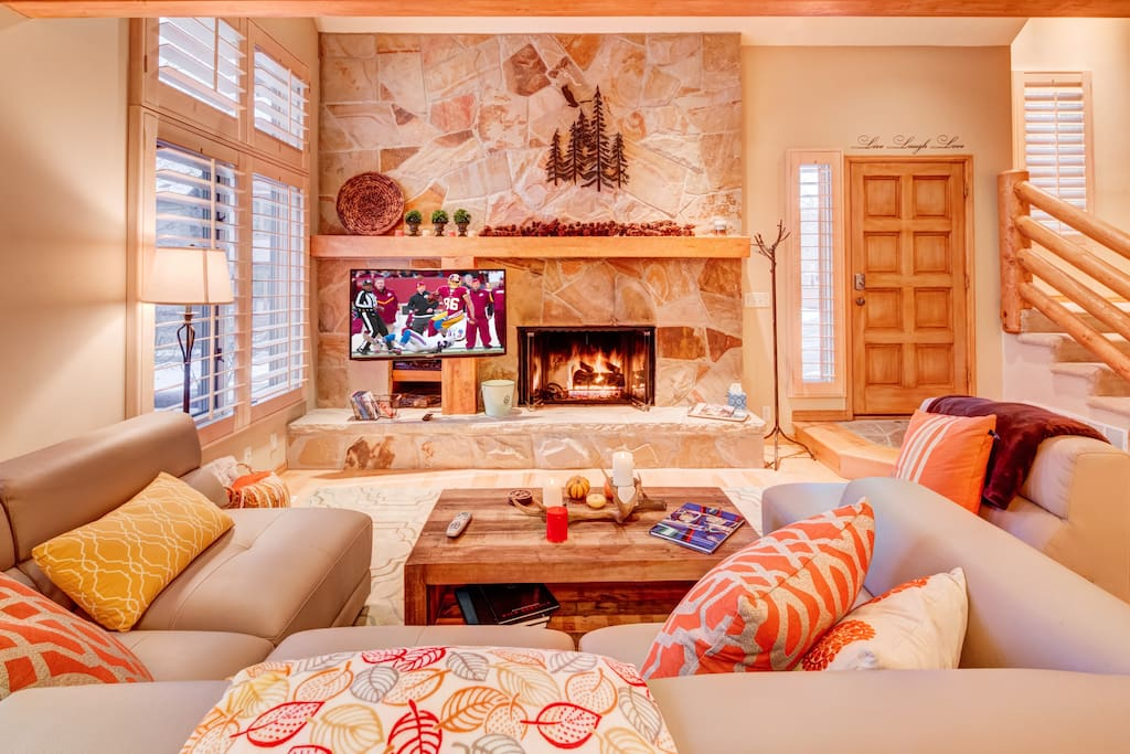 Living room with plenty of comfortable seating, HDTV and gas fireplace
