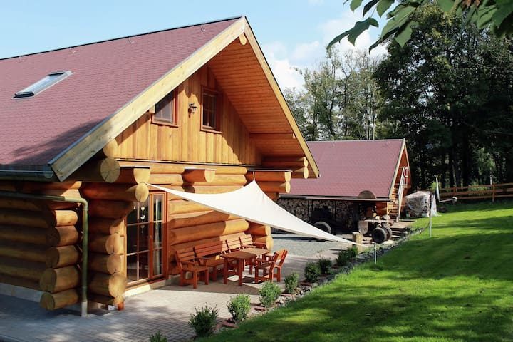 Modernly furnished wooden house with wood stove in the middle of Thuringia's hiking paradise