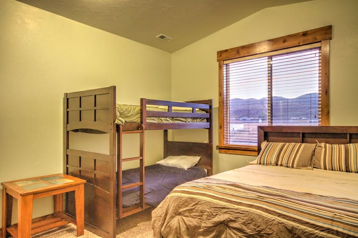 Main level bedroom with queen and twin bunk beds looking out to an awesome mountain view