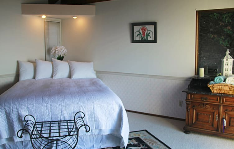 Your Master bedroom suite with a California King sized bed.