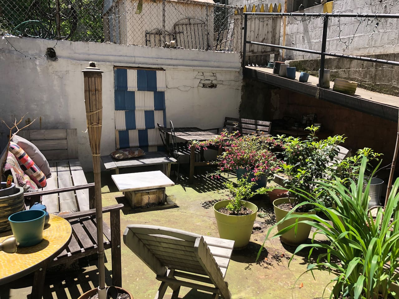 Our private backyard, great for summer breakfasting and evening drinks