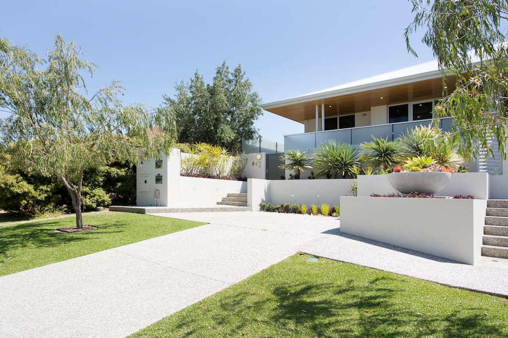Private driveway / Landscaped gardens
