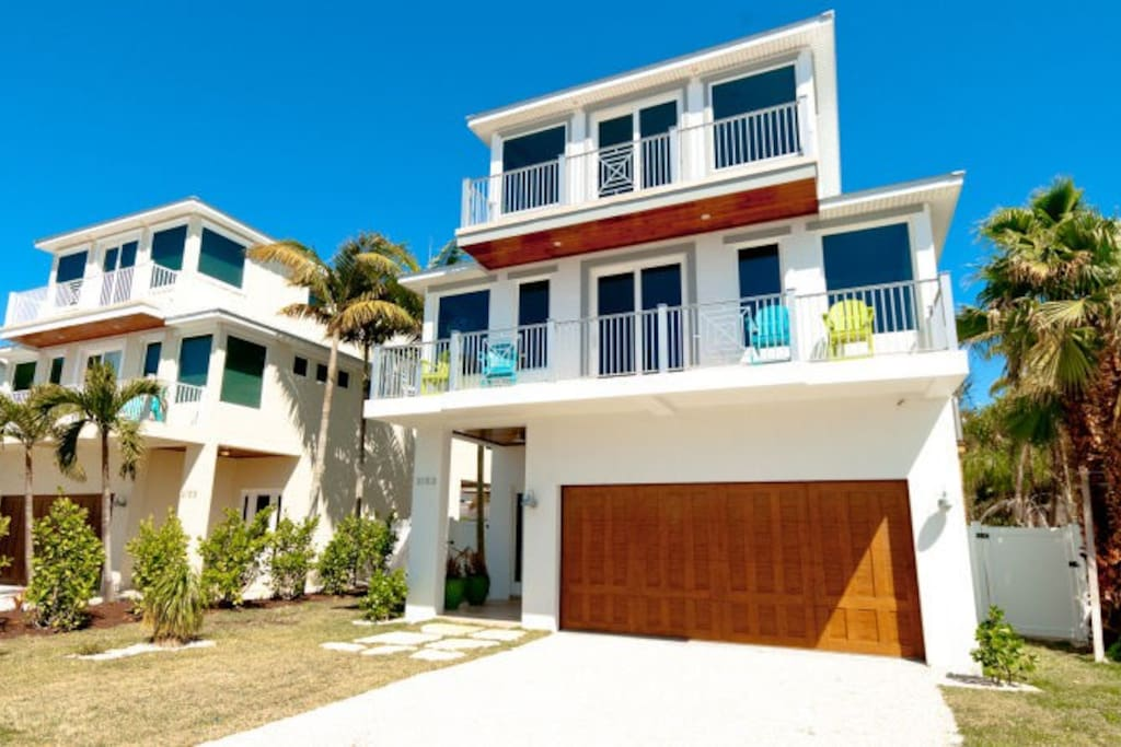 Stunning 5 bedroom pool home just steps from the beach for 9 bedroom beach house rental