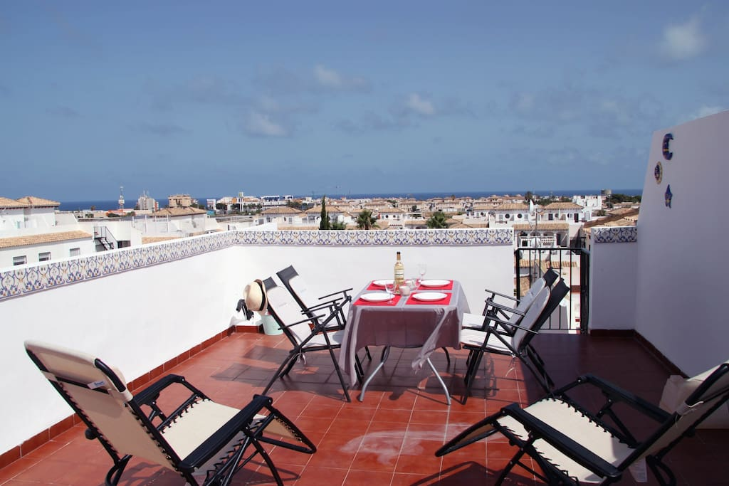 Enjoy a meal or just rest in sun chairs in privacy of the rooftop terrace.