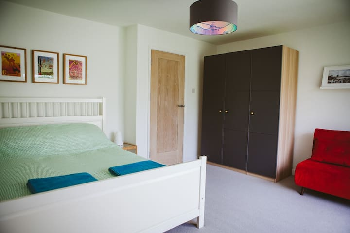 Large bedroom on the first floor with access to a balcony overlooking the garden.