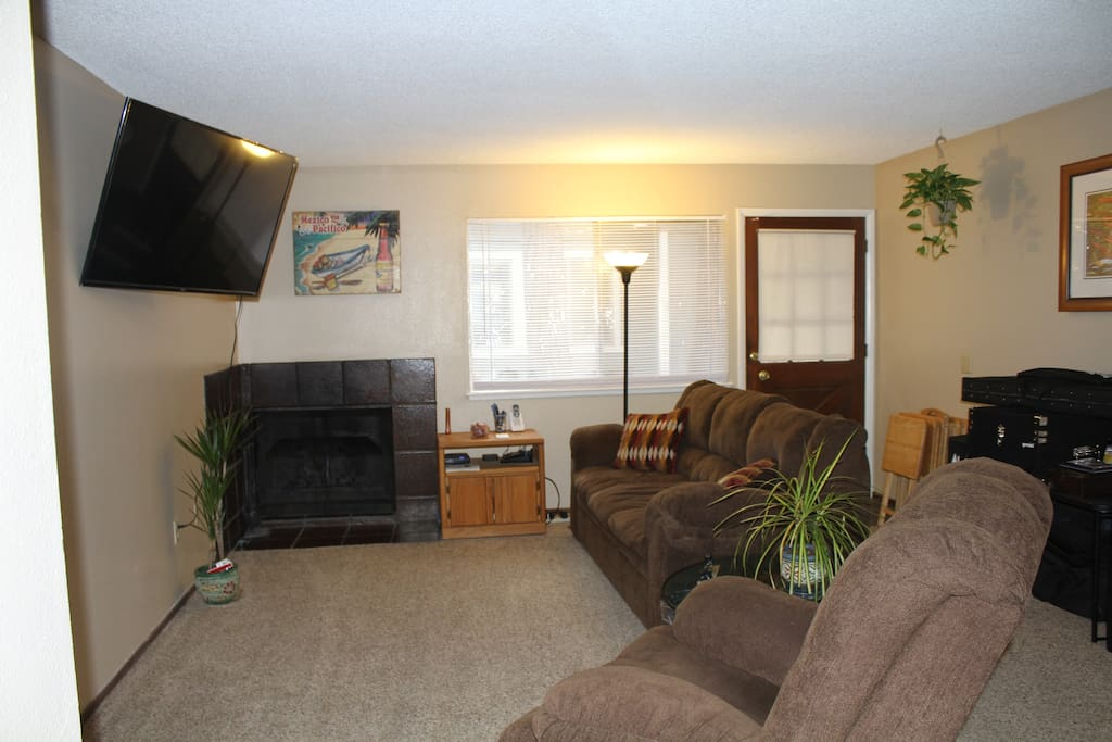 "Comfortable living room with  55"" flat screen television"