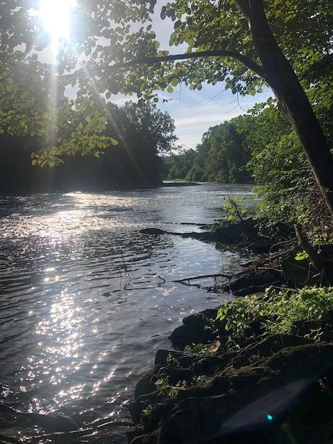 Shenandoah log cabin on the river