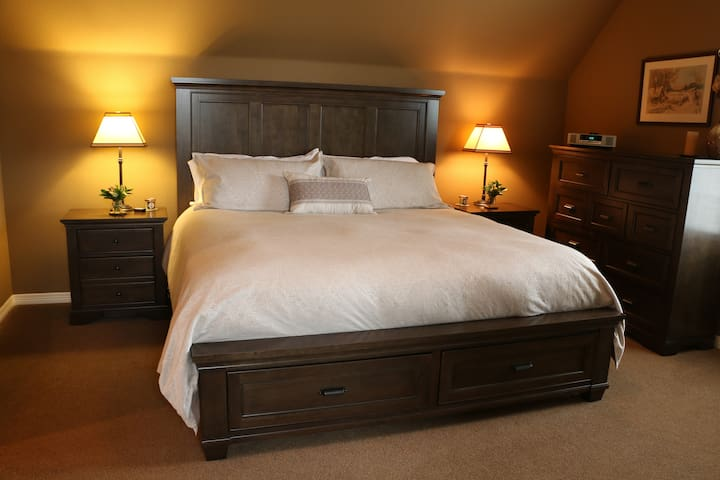 Bedroom includes; king bed with drawer storage, 2 night stands with 3 drawers, large dresser, desk and full length mirror.