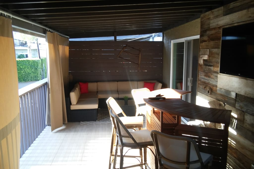 Enclosed outdoor private patio with Bar, TV, BBQ and Stove