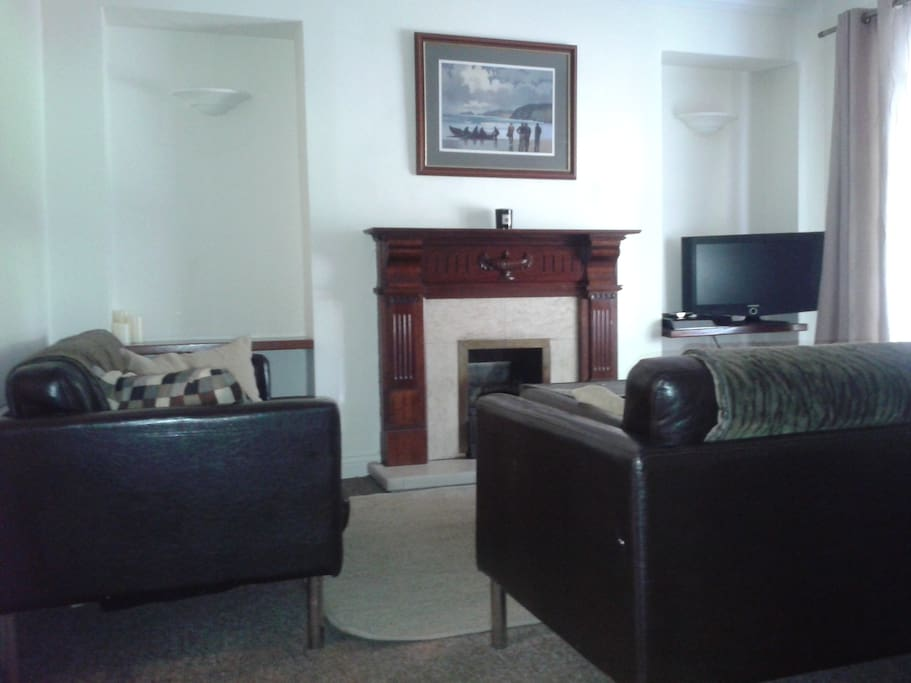 Large sitting room area with TV and gas fire