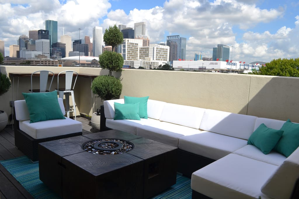 Amazing views of downtown! With outdoor TV and seating for 8.