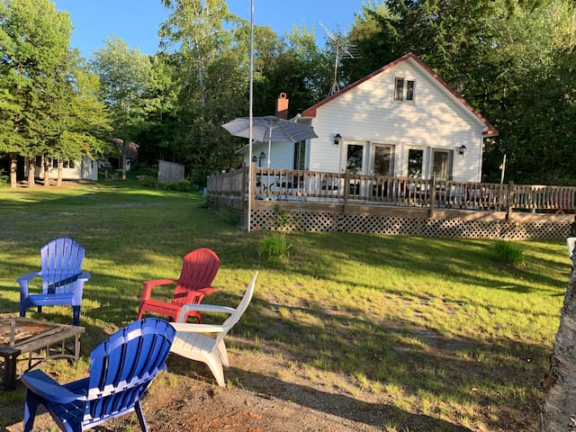 Cottage with one bedroom and one bath plus deck. Detached seasonal bunkhouse has two additional sleeping rooms.