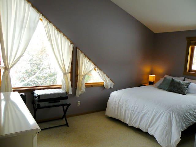 second floor north-facing bedroom, queen bed, vineyard view