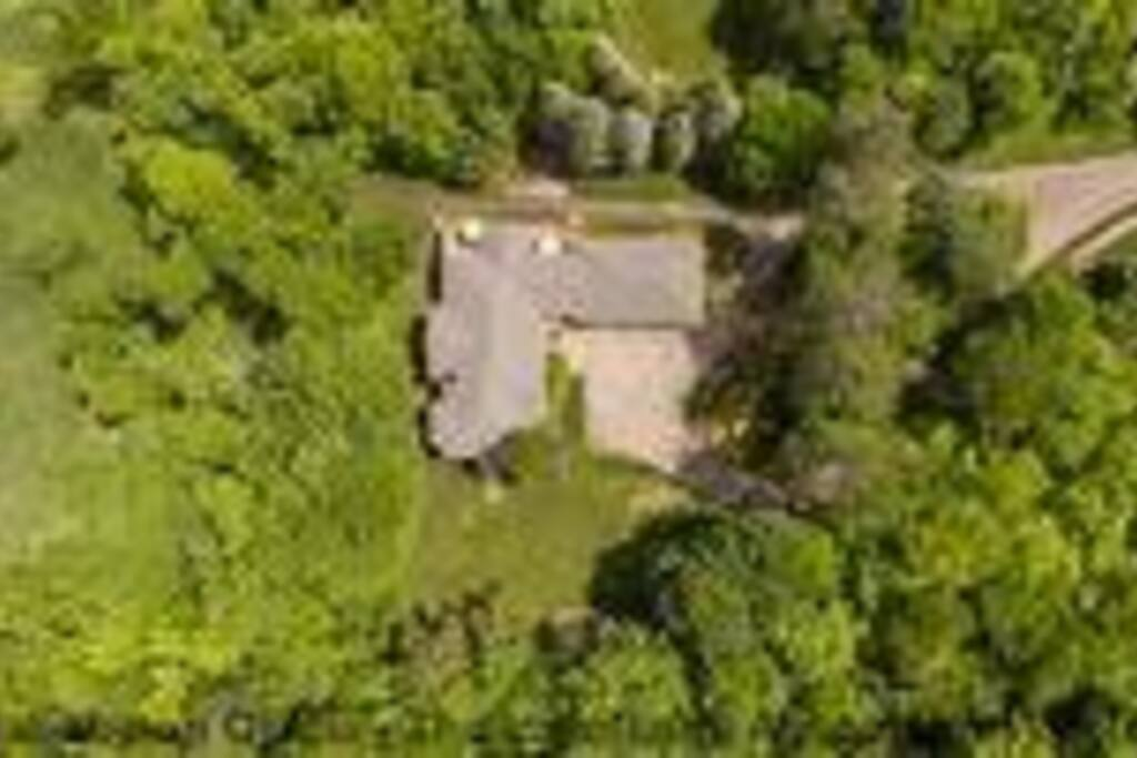 6 acres of wooded private property with tennis & athletic court