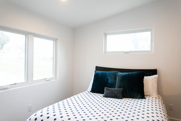 Enjoy a plush queen size bed