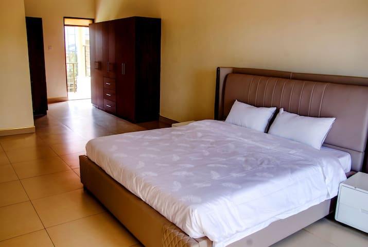 Bedroom Two & Closets + Back Balcony