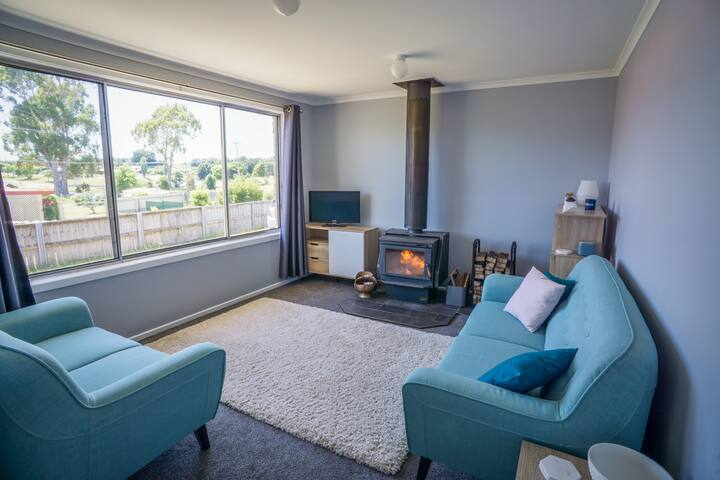 Lounge Room - with a cosy fireplace for when it gets chilly - has views of both the lake and Mt Bischoff.