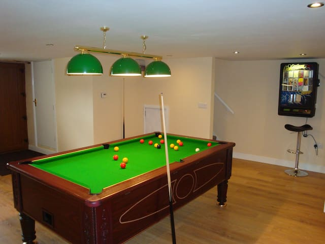 Games room with pool table, darts board, XBox and Table football