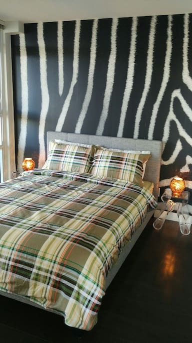 Cozy bedroom with special wall paper.  Brand new high quality mattress and bed sheets!