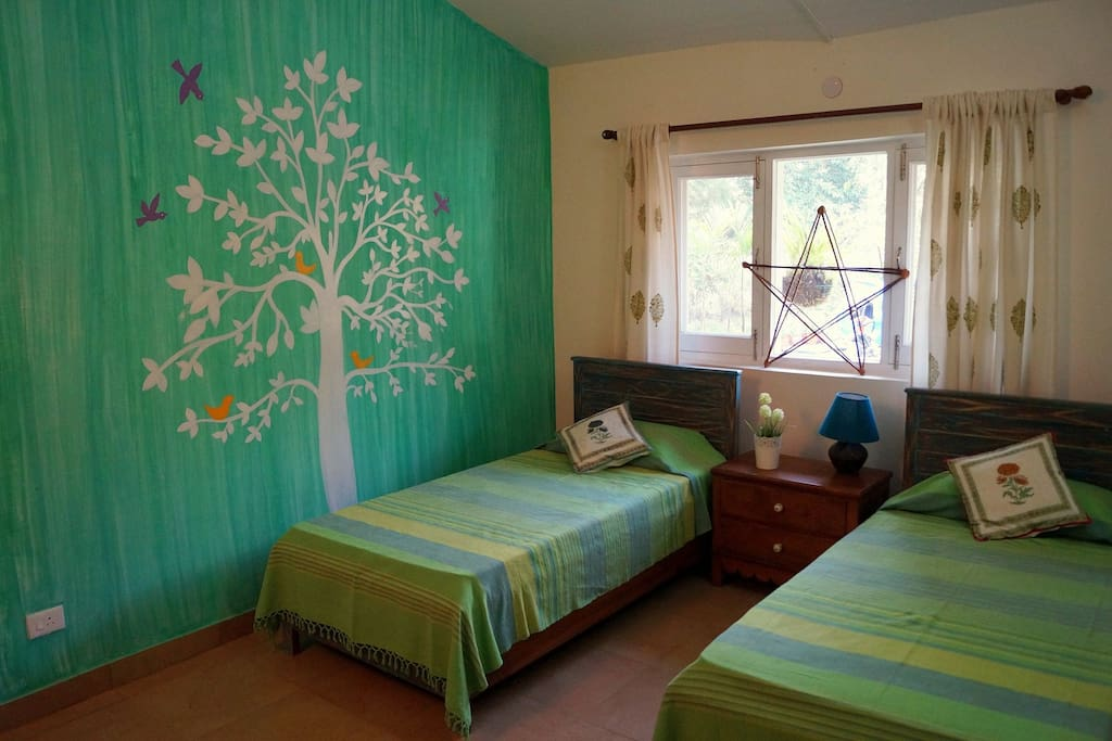 This is the second room that has two single beds. The beds can be also joined together if the guests so desire. This room can also be made into a cosy living room if a single guest or couple would like some additional space. pictures of this same room made into a living room are attached.