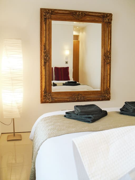Beautiful mirror in a fantastic bedroom. Professional Hairdryer for you to look your best.