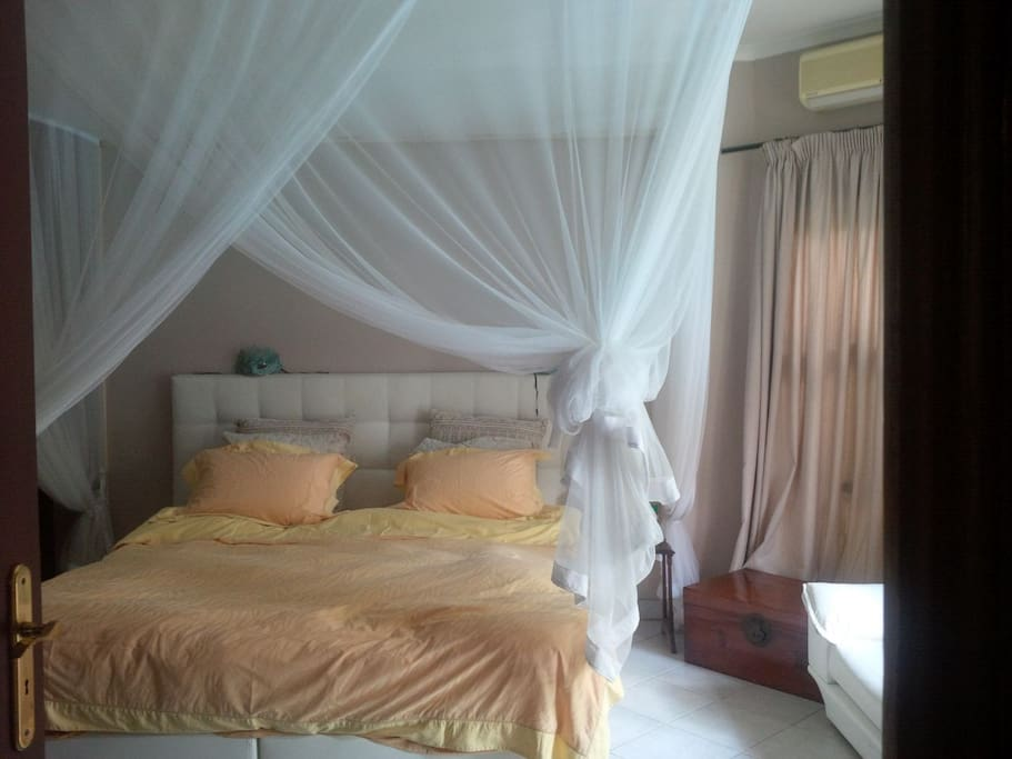 Bedroom with moschito net