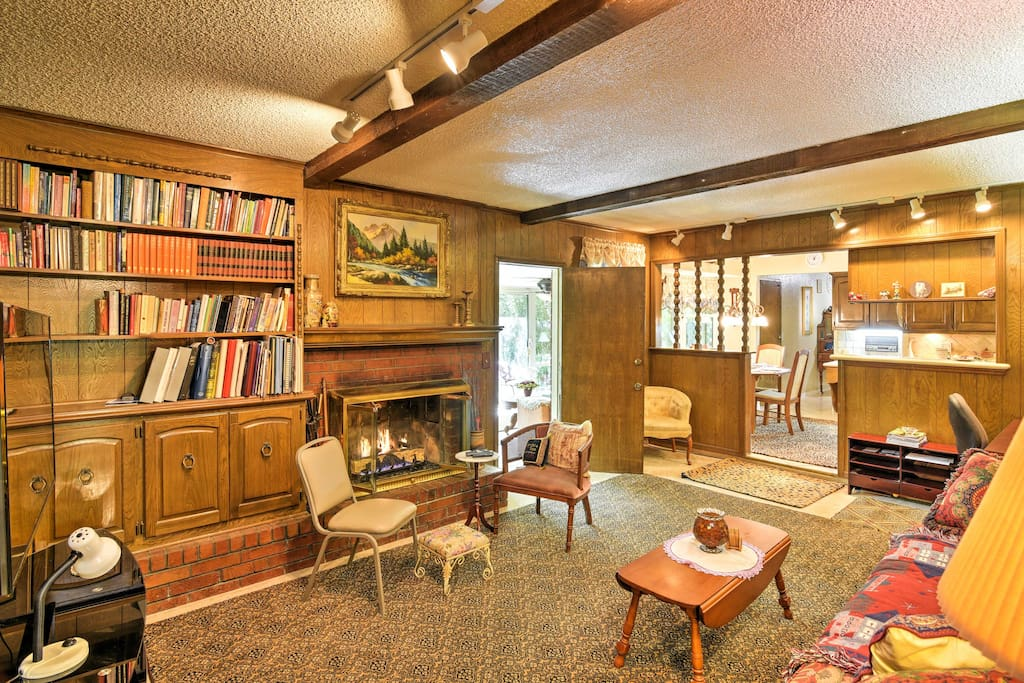 Grab a book from the shelf and relax in the well-decorated sitting room.