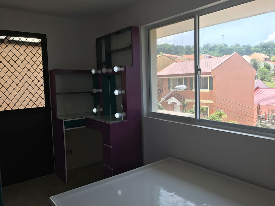 The Master's Bedroom with adjoining balcony. It's on the 3rd level with great view. Adjoining balcony is airy and overlooking the city and Azienda's very peaceful community.