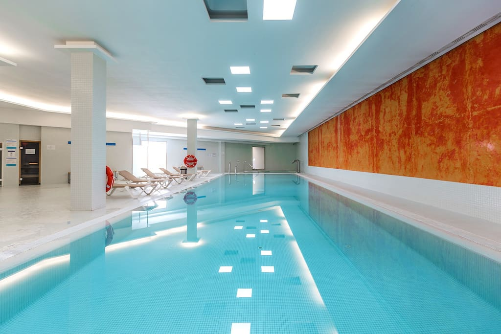 You have access to two large outdoor pools, a heated indoor pool, gym, sauna and Turkish bath