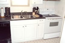 All appliances are virtually new.  Kitchen is fully stocked with dishes, cookware and baking items.